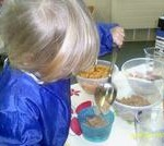 Child using the self serve breakfast area